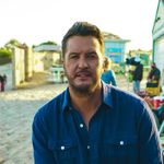 Watch Luke Bryan Change a Tire and Impersonate Elvis – But Not at the Same Time
