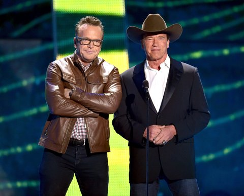 Arnold Schwarzenegger, Tom Arnold present at the 2015 CMT Music Awards on June 10, 2015, in Nashville.