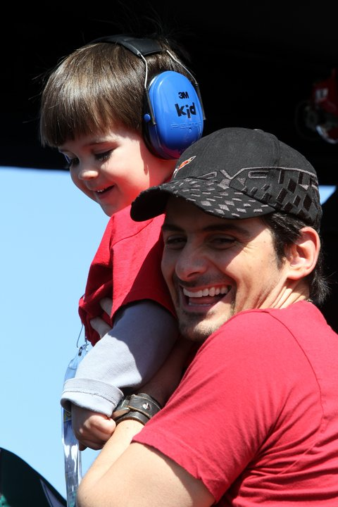 DAYTONA BEACH, FL - FEBRUARY 20:  Musician Brad Paisley looks on with his son during the NASCAR Sprint Cup Series Daytona 500 at Daytona International Speedway on February 20, 2011 in Daytona Beach, Florida.  (Photo by Jerry Markland/Getty Images for NASCAR)