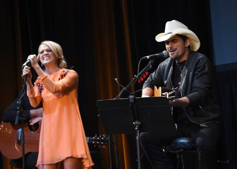 NEW YORK, NY - OCTOBER 06:  Carrie Underwood and  Brad Paisley perform onstage at The Country Music Hall Of Fame & Museum All For The Hall New York Benefit Concert at PlayStation Theater on October 6, 2015 in New York City.  (Photo by Rick Diamond/Getty Images for Country Music Hall Of Fame)
