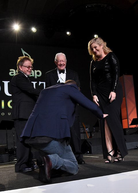 Justin Timberlake, ASCAP President and Chairman of the Board Paul Williams, and President Jimmy Carter present Trisha Yearwood (R) with the Voice of Music Award onstage during the 53rd annual ASCAP Country Music awards at the Omni Hotel on November 2, 2015 in Nashville, Tennessee. (Photo by Michael Loccisano/Getty Images)