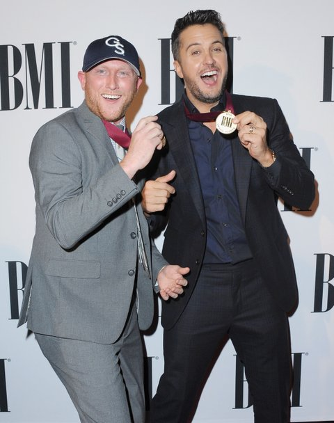 NASHVILLE, TN - NOVEMBER 03:  Cole Swindell (L) and Luke Bryan attend the 63rd annual BMI Country awards on November 3, 2015 in Nashville, Tennessee.  (Photo by Jon Kopaloff/FilmMagic)