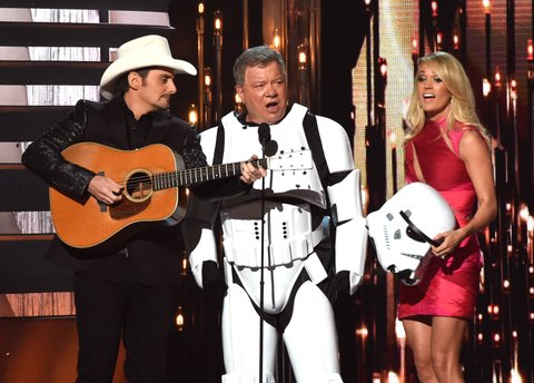 NASHVILLE, TN - NOVEMBER 04:  Co-host Brad Paisley, actor William Shatner, and co-host Carrie Underwood speak onstage at the 49th annual CMA Awards at the Bridgestone Arena on November 4, 2015 in Nashville, Tennessee.  (Photo by Rick Diamond/Getty Images)