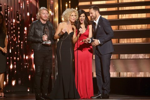 NASHVILLE, TN - NOVEMBER 04: (L-R) Phillip Sweet, Kimberly Schlapman, Karen Fairchild, and Jimi Westbrook of Little Big Town accept the award for Vocal Group of the Year onstage at the 49th annual CMA Awards at the Bridgestone Arena on November 4, 2015 in Nashville, Tennessee. (Photo by Terry Wyatt/WireImage)