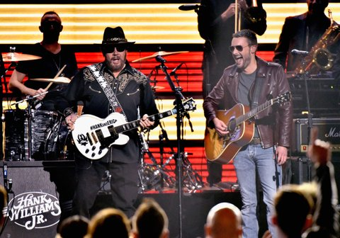NASHVILLE, TN - NOVEMBER 04: Hank Williams, Jr. and Eric Church perform onstage at the 49th annual CMA Awards at the Bridgestone Arena on November 4, 2015 in Nashville, Tennessee. (Photo by Frederick Breedon/FilmMagic)
