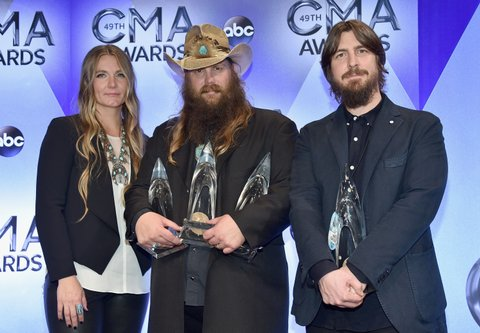 NASHVILLE, TN - NOVEMBER 04:  (L-R) Morgane Stapleton, singer-songwriter Chris Stapleton with his Album of the Year, New Artist of the Year, and Male Vocalist of the Year awards, and producer Dave Cobb with his Album of the Year award pose in the press room at the 49th annual CMA Awards at the Bridgestone Arena on November 4, 2015 in Nashville, Tennessee.  (Photo by John Shearer/WireImage)