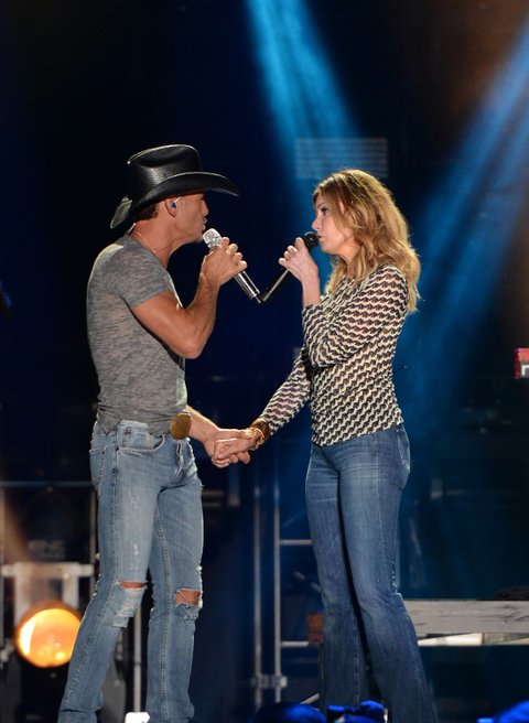 NASHVILLE, TN - JUNE 05:  Tim McGraw and wife Faith Hill perform onstage during the 2014 CMA Festival at LP Field on June 5, 2014 in Nashville, Tennessee.  (Photo by C Flanigan/FilmMagic)