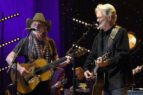 NASHVILLE, TENNESSEE - MARCH 16:  Willie Nelson and Kris Kristofferson perform at The Life & Songs of Kris Kristofferson produced by Blackbird Presents at Bridgestone Arena on March 16, 2016 in Nashville, Tennessee.  (Photo by Rick Diamond/Getty Images for Essential Broadcast Media)