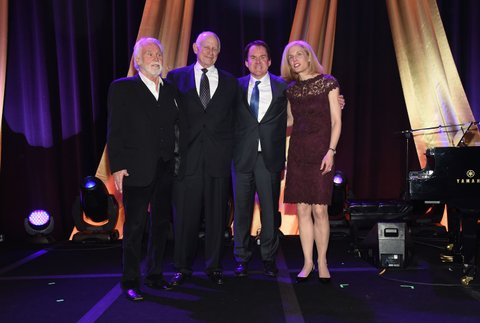 NASHVILLE, TN - FEBRUARY 29: Honorees Kenny Rogers, Aubrey Harwell, Brian Phillips, and Dr. Jennifer Pietenpol gather at the T.J. Martell Foundation 8th Annual Nashville Honors Gala at the Omni Nashville Hotel on February 29, 2016 in Nashville, Tennessee.  (Photo by Rick Diamond/Getty Images for T.J. Martell)