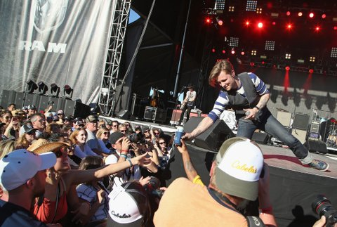 LAS VEGAS, NEVADA - APRIL 02:  Singer Frankie Ballard is given a beer from a fan as he performs onstage at the 4th ACM Party for a Cause Festival at the Las Vegas Festival Grounds on April 2, 2016 in Las Vegas, Nevada.  (Photo by Gabe Ginsberg/WireImage)