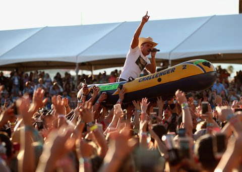 LAS VEGAS, NEVADA - APRIL 02:  Singer Dustin Lynch rides a raft over the crowd while performing at the 4th ACM Party for a Cause Festival at the Las Vegas Festival Grounds on April 2, 2016 in Las Vegas, Nevada.  (Photo by Christopher Polk/Getty Images for ACM)