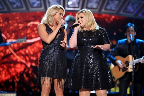 NASHVILLE, TN - DECEMBER 15: Recording artists Miranda Lambert (L) and Kelly Clarkson perform onstage during the 2014 American Country Countdown Awards at Music City Center on December 15, 2014 in Nashville, Tennessee. (Photo by Christopher Polk/Getty Images for dcp)