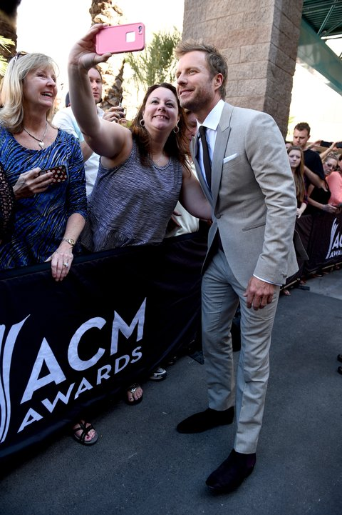 LAS VEGAS, NEVADA - APRIL 03: Host Dierks Bentley (R) poses for a selfie photo with a fan at the 51st Academy of Country Music Awards at MGM Grand Garden Arena on April 3, 2016 in Las Vegas, Nevada. (Photo by Larry Busacca/ACM2016/Getty Images for dcp)