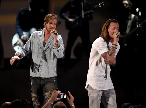 LAS VEGAS, NEVADA - APRIL 03: Recording artists Brian Kelley (L) and Tyler Hubbard of music group Florida Georgia Line perform onstage during the 51st Academy of Country Music Awards at MGM Grand Garden Arena on April 3, 2016 in Las Vegas, Nevada.