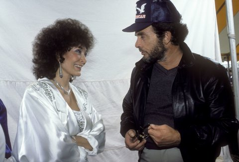 Loretta Lynn and Merle Haggard performing at Farm Aid in Champaigne, Illinois on September 22, 1985.