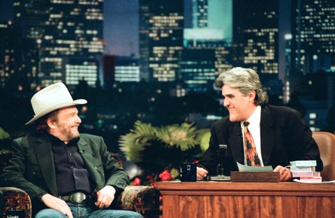 THE TONIGHT SHOW WITH JAY LENO -- Episode 841 -- Pictured: (l-r) Musical guest Merle Haggard during an interview with host Jay Leno on January 15, 1996 -- (Photo by: NBC/NBCU Photo Bank via Getty Images)