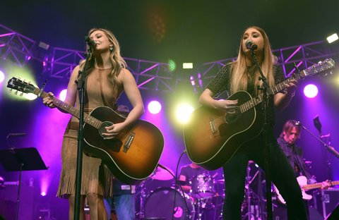 NASHVILLE, TENNESSEE - APRIL 12:  Taylor Dye (L) and Madison Marlow of Maddie & Tae perform onstage during All For The Hall at the Bridgestone Arena on April 12, 2016 in Nashville, Tennessee.  (Photo by John Shearer/Getty Images for The Country Music Hall Of Fame & Museum)