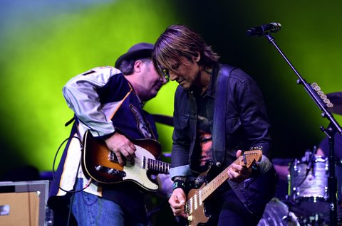 NASHVILLE, TENNESSEE - APRIL 12:  Vince Gill (L) and Keith Urban perform onstage during All For The Hall at the Bridgestone Arena on April 12, 2016 in Nashville, Tennessee.  (Photo by John Shearer/Getty Images for The Country Music Hall Of Fame & Museum)