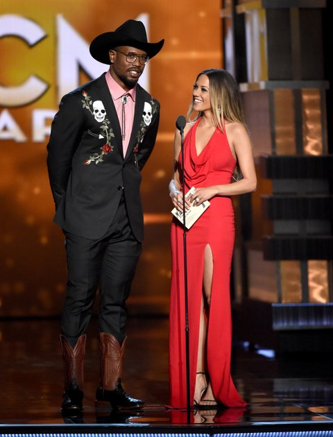 Von Miller and Jana Kramer onstage during the 51st Academy of Country Music Awards at MGM Grand Garden Arena on April 3, 2016 in Las Vegas, Nevada.