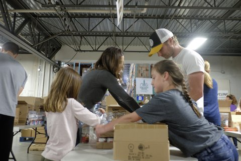YouTube sensation, Robby Novak (aka Kid President) assembles food packs with local volunteers for the Second Harvest Food Bank of Middle Tennessee to benefit kids in need on Tuesday, May 10, 2016, in Nashville, Tenn. during a Town Hall and volunteer night hosted by ConAgra. (Photo by Jon Morgan/Invision for ConAgra/AP Images)