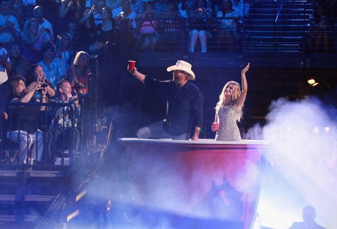 NASHVILLE, TN - JUNE 06: Hosts Toby Keith and Kristen Bell speak during the 2012 CMT Music awards at the Bridgestone Arena on June 6, 2012 in Nashville, Tennessee. (Photo by FilmMagic/FilmMagic)