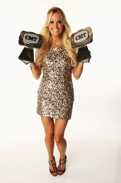 NASHVILLE, TN - JUNE 06:  Carrie Underwood poses with awards in the Wonderwall.com Portrait Studio during 2012 CMT Music awards at the Bridgestone Arena on June 6, 2012 in Nashville, Tennessee.  (Photo by Christopher Polk/Getty Images for CMT)