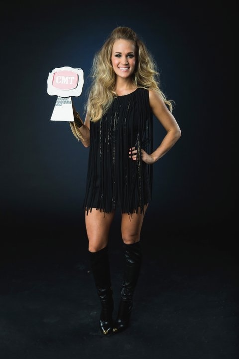 NASHVILLE, TN - JUNE 04:  Winner, Video of the Year award, Carrie Underwood poses at the 2014 CMT Music Awards - Wonderwall Portrait Studio at Bridgestone Arena on June 4, 2014 in Nashville, Tennessee.  (Photo by Christopher Polk/Getty Images for Wonderwall)