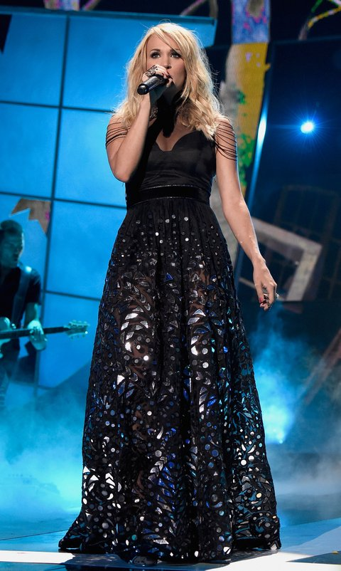 Carrie Underwood performs onstage during the 2015 CMT Music awards at the Bridgestone Arena on June 10, 2015 in Nashville, Tennessee.