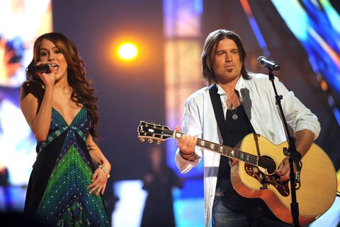Miley Cyrus and Billy Ray Cyrus perform on stage during the 2008 CMT Music Awards at the Curb Events Center at Belmont University on April 14, 2008 in Nashville, Tennessee.