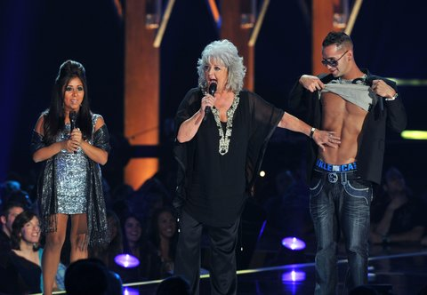 (L-R) TV personalities Nicole 'Snooki' Polizzi, Paula Deen and Mike 'The Situation' Sorrentino speaks onstage during the 2010 CMT Music Awards at the Bridgestone Arena on June 9, 2010 in Nashville, Tennessee. (Photo by Frederick Breedon IV/WireImage)