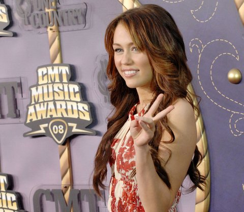 Singer Miley Cyrus attends the 2008 CMT Music Awards at the Curb Events Center at Belmont University on April 14, 2008 in Nashville, Tennessee. (Photo by Jon Kopaloff/FilmMagic)