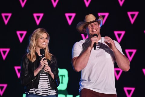 NASHVILLE, TN - JUNE 07:  Sportscaster Erin Andrews and football player J.J. Watt speak on stage during rehearsals at Bridgestone Arena on June 7, 2016 in Nashville, Tennessee.  (Photo by Mike Coppola/Getty Images for CMT)