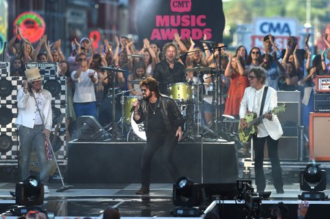 NASHVILLE, TN - JUNE 08: Robin Zander, Rick Nielsen, Tom Petersson and Daxx Nielsen from musical group Cheap Trick and singer-songwriter Billy Ray Cyrus onstage during the 2016 CMT Music awards at the Bridgestone Arena on June 8, 2016 in Nashville, Tennessee. (Photo by Erika Goldring/Getty Images for CMT)