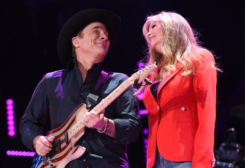 NASHVILLE, TN - JUNE 10:  Singer-songwriter Clint Black and actress Lisa Hartman Black perform onstage during 2016 CMA Festival - Day 2 at Nissan Stadium on June 10, 2016 in Nashville, Tennessee.  (Photo by Rick Diamond/Getty Images)