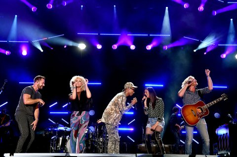 NASHVILLE, TN - JUNE 12:  (L-R) Jimi Westbrook and Kimberly Schlapman of Little Big Town, singer Pharrell Williams, and Karen Fairchild and Phillip Sweet of Little Big Town perform onstage during 2016 CMA Festival - Day 4 at Nissan Stadium on June 12, 2016 in Nashville, Tennessee.  (Photo by John Shearer/Getty Images)