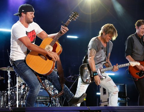 NASHVILLE, TN - JUNE 12:  Luke Bryan performs with Keith Urban at the CMA Fest at Nissan Stadium on June 12, 2016 in Nashville, Tennessee.  (Photo by Frederick Breedon IV/WireImage)