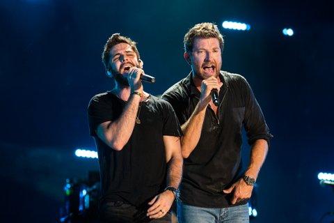 NASHVILLE, TN - JUNE 12: Thomas Rhett and Brett Eldredge perform during the 2016 CMA Music Festival at Nissan Stadium on June 12, 2016 in Nashville, Tennessee. (Photo by Richard Gabriel Ford/Getty Images)