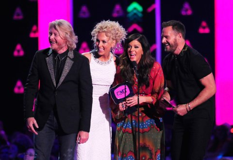 NASHVILLE, TN - JUNE 08: Little Big Town's Phillip Sweet, Kimberly Schlapman, Karen Fairchild, and Jimi Westbrook accept an award onstageduring the 2016 CMT Music awards at the Bridgestone Arena on June 8, 2016 in Nashville, Tennessee. (Photo by FilmMagic/FilmMagic)