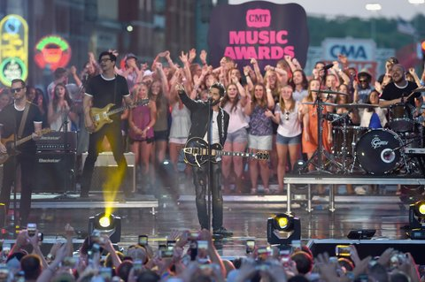 NASHVILLE, TN - JUNE 08: Singer-songwriter Thomas Rhett performs onstage during the 2016 CMT Music awards at the Bridgestone Arena on June 8, 2016 in Nashville, Tennessee. (Photo by Erika Goldring/Getty Images for CMT)