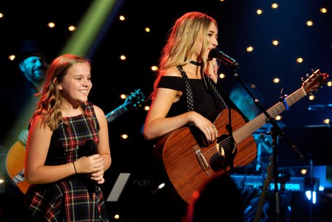NASHVILLE, TN - JULY 13:  Maisy Stella (L) and Lennon Stella perform onstage during Skyville Live Salutes the Magic of Music City on July 13, 2016 in Nashville, Tennessee.  (Photo by Frederick Breedon/Getty Images for Skyville)