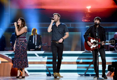 NASHVILLE, TN - AUGUST 30:  Singer-songwriters   Hillary Scott, Charles Kelley and musician Dave Haywood from muscial group Lady Antebellum perform onstage during the 10th Annual ACM Honors at the Ryman Auditorium on August 30, 2016 in Nashville, Tennessee.  (Photo by John Shearer/Getty Images for ACM)