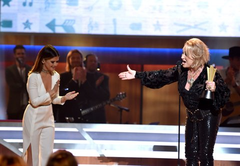 NASHVILLE, TN - AUGUST 30:  Musicial artists Maren Morris presents an award to Tanya Tucker onstage at the Ryman Auditorium on August 30, 2016 in Nashville, Tennessee.  (Photo by John Shearer/Getty Images for ACM)