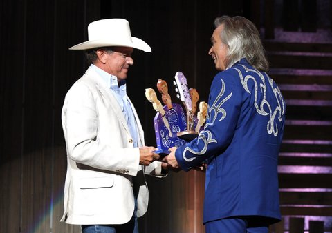 NASHVILLE, TN - SEPTEMBER 21:  George Strait presents Jim Lauderdale with the Wagon Master Award onstage at the Americana Honors & Awards 2016 at Ryman Auditorium on September 21, 2016 in Nashville, Tennessee. at Ryman Auditorium on September 21, 2016 in Nashville, Tennessee.  (Photo by Terry Wyatt/Getty Images for Americana Music)
