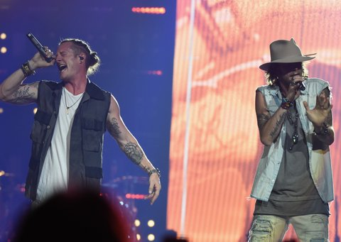 NASHVILLE, TN - OCTOBER 13:  Tyler Hubbard and Brian Kelly of Florida Georgia Line perform during their Dig Your Roots 2016 Tour at Bridgestone Arena on October 13, 2016 in Nashville, Tennessee.  (Photo by Rick Diamond/Getty Images)