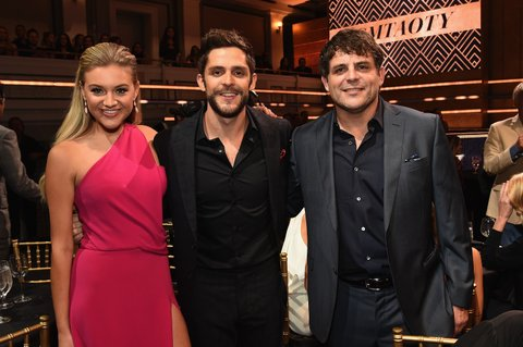 NASHVILLE, TN - OCTOBER 19:  (L-R) Kelsea Ballerini, Thomas Rhett and Rhett Akins take photos during CMT Artists of the Year 2016 on October 19, 2016 in Nashville, Tennessee.  (Photo by Rick Diamond/Getty Images for CMT)