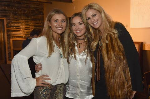 NASHVILLE, TN - NOVEMBER 01:  Singer-songwriters Hannah Mulholland, Naomi Cooke and Jennifer Wayne of Runaway June take photos together before CMT's Next Women of Country on November 1, 2016 in Nashville, Tennessee.  (Photo by Rick Diamond/Getty Images for CMT)