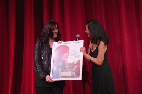 NASHVILLE, TN - NOVEMBER 01:  Singer-songwriter Brandy Clark (L) recieves an award onstage from Senior Vice President of Music Strategy for CMT Leslie Fram (R) during CMT's Next Women of Country on November 1, 2016 in Nashville, Tennessee.  (Photo by Rick Diamond/Getty Images for CMT)