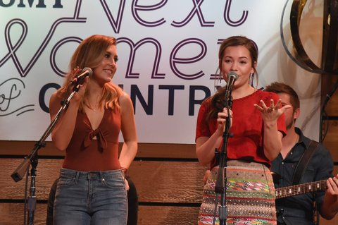 NASHVILLE, TN - NOVEMBER 01:  Maddie Marlow (L) and Tae Dye (R) of Maddie and Tae, perform onstage during CMT's Next Women of Country on November 1, 2016 in Nashville, Tennessee.  (Photo by Rick Diamond/Getty Images for CMT)