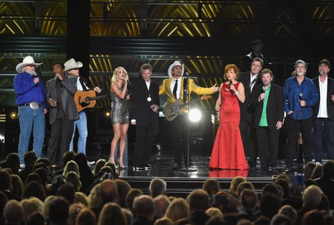 NASHVILLE, TN - NOVEMBER 02:  (L-R) Charlie Daniels, Charley Pride, Dwight Yoakam, Carrie Underwood, Randy Travis, Brad Paisley, Reba McEntire, Vince Gill, Jeff Cook, Randy Owen, and Teddy Gentry perform onstage at the 50th annual CMA Awards at the Bridgestone Arena on November 2, 2016 in Nashville, Tennessee.  (Photo by Rick Diamond/Getty Images)