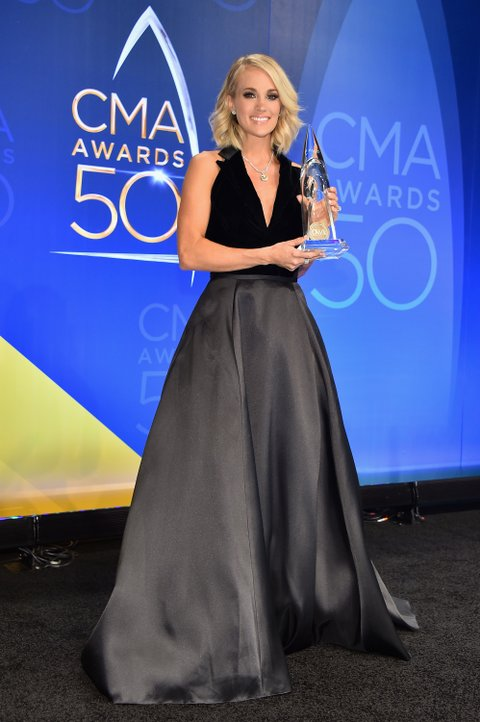 NASHVILLE, TN - NOVEMBER 02: Carrie Underwood poses with the award for Female Vocalist of the Year in the press room at the The 50th Annual CMA Awards at Bridgestone Arena on November 2, 2016 in Nashville, Tennessee.  (Photo by Michael Loccisano/Getty Images for Carrie Underwood)